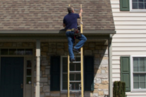 Roofer on a ladder
